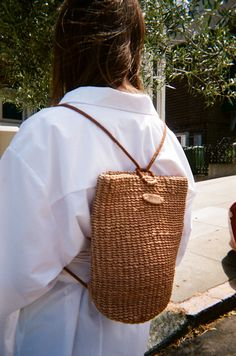 """Early '90s ESPRIT natural woven straw backpack with leather straps.Dimensions: 11"""" deep, ..."""