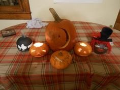 Fax family pumpkins | Zach's pumpkin is front and center with Shadowfax's big pumpkin flanked by four pumpkins decorated by Kagome.