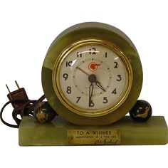 """1941 Pontiac Presentation Clock This wonderful clock was given in 1941 in appreciation of a fine job. Mounted on a green marble base measuring 7"""" wide by 2½""""deep. Clock is mounted in a 5"""" diameter green marble disk. This clock was made by Seth Thomas is electric and is in fine working order. Pontiac logo is imprinted on the clock face, not the glass."""