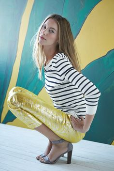 Pair printed metallic pants with a simple striped shirt.