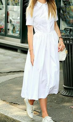 Dress and sneakers. Cool dress. Love the summer outfit, perfect for a hot day.