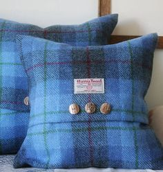 Bluebell Harris Tweed Throw Pillows. A great detail with the buttons and label.