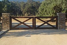 Steel framed double swing driveway gates wrapped with wood with a wire infill make a great entrance for this Woodside horse ranc Farm Gate, Farm Fence, Fence Gate, Fences, Front Yard Fence, Front Gates, Entrance Gates, Farm Entrance, Driveway Entrance