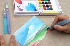 Watercolors. Click through to see our brush pen picks!