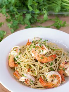 Prawns Aglio e Olio Note: This was first posted in Jun 2008, now updated with new photos and improved recipe. I really love Aglio e Olio, and it is my go-to one-dish pasta dish whenever I am out of ideas of what to cook. While the original and authentic recipe for Aglio e Olio is plain, it is now