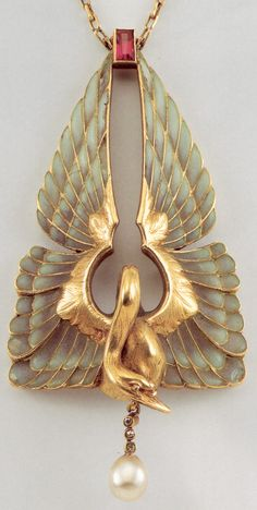 Philippe Wolfers Pendentif. 1858-1929 (Belgium). The outstanding works of Philippe Wolfers were of great importance for Art Nouveau.  Inspired by the Symbolism Movement and its dream like themes, he used gold, precious stones and expensive materials, to create luxurious jewelry, with floral, animal and natural designs, sensual female forms, with fluid, sinuous symbolic ornaments.