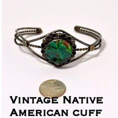 """Native American Vintage Sterling Green Stone Cuff This is a Beautiful Vintage Native American Sterling Silver Green Stone Ornate Cuff Bracelet. Measures 6.75"""" in circumference around the inside as it sits now but is adjustable. Marked Sterling 925. The bracelet is in great vintage condition & has not been cleaned due to age. The green stone is stunning w/ swirls all throughout it & is 18mm in diameter. Weighs 16.81 grams. A beautiful vintage piece to add to your jewelry! I Ship out same day…"""