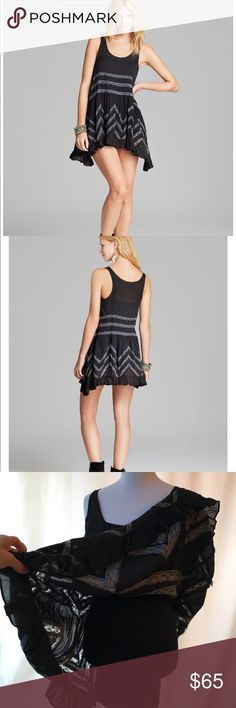 🎉SALE! Free People Black Trapeze Dress WITH SLIP! A trapeze cut eases the fit of this polka-dot Free People tank, and lace insets add a romantic touch. Ruffled hem. Semi-sheer.  • Fabric: Voile. • Shell: 100% rayon. • Trim: 100% nylon. • Hand wash. Reasonable offers accepted. 20% off bundles! ** INCLUDES SLIP!** MEASUREMENTS Length: 29in / 73.5cm, from shoulder Free People Dresses Mini