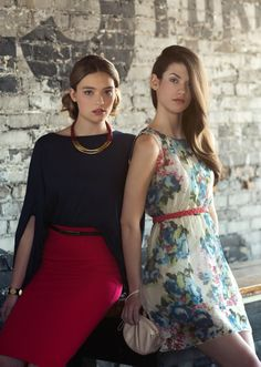 A few of our dressier pieces... Fleur is wearing a C'est Moi kimono top and pencil skirt, while Jenn is wearing our floral printed silk dress