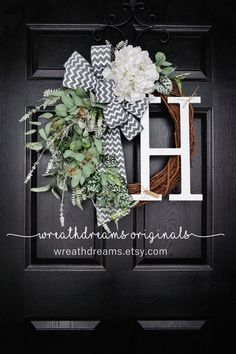 Infuse seasonal cheer into your living space with this Spring wreath featuring a large Hydrangea bloom & lots of vivid green foliage and variegated leaves that will add a nature's touch to your front door. This beautiful wreath is accented with a trendy gray & white chevron burlap ribbon. Add an optional monogram for personalization. Hurry & purchase one today! I only have a few quantity of these wreaths :) ***Wreath shown is a 20-inch wreath with a 14-inch Block monogram. ❤ All...