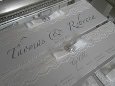 Beautiful pearl and lace ornate mirror table plan x www.uberflyinvites.co.uk