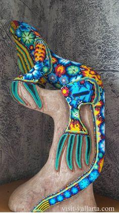 Iguana done in Huichol art.    #PuertoVallarta #Jalisco #RivieraNayarit #Nayarit #Mexico #BanderasBay #Travel #Huichol #Art #Huicholart.  For more information, visit the ultimate Puerto Vallarta travel guide: visit-vallarta.com