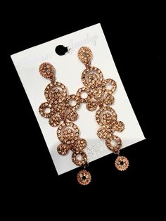 Stunning long rose gold earrings! A must have!