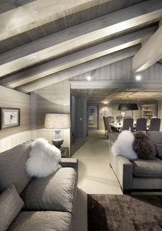 gorgeous grey ski chalet - Chalet White Pearl by Philippe Capezzone. Love the large square dining table.