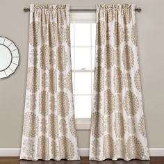 This curtain serves 2 functions as it enlivens the mood in any room with it's soft tone colors and beautiful array of medallions. Despite it's graceful and chic appearance, it also offers room darkening capabilities and which combine beauty and convenience in 1 product.