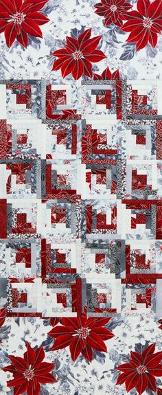 Use a straight furrows setting for Log Cabin blocks in an icy winter color scheme to create a striking seasonal table runner. Fabrics are from the Winter Blossom collection by Hoffman California Fabrics [1]. [1] http://hoffmanfabrics.com