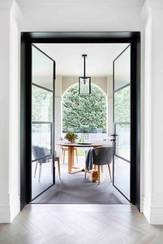 Large steel framed doors opening to outdoor patio of Spanish style home. House Inspiration, Loft Style, Spanish Style Home, Australian Homes, Home, Maximalist Interior, Melbourne House, Seaside Cottage, Modern