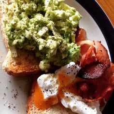 Smashed avocado with Danish feta drizzled with lemon juice cracked pepper crispy bacon and a runny poached egg #heaven