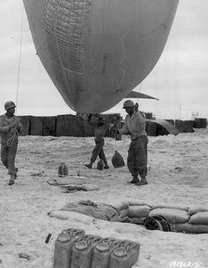 D-Day barrage balloons, being installed by support troops...