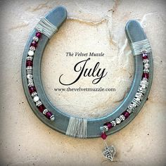 July Birthstone Ruby Personalized Birthstone Horseshoe. Each of our Personalized Birthstone Horseshoes is meticulously custom hand-crafted on an authentic steel horseshoe. We beautifully embellish each one with a single name of your choice in pewter (max. of 10 letters), a combination of sterling, Bali, Thai, Tibetan and plated silvers accented with rhodium pewter beads and brilliant Swarovski Xilion Ruby Birthstone Crystals - The birthstone color for July! We finish each design with a…