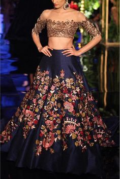 Model IS Looking Sizzling Hot In The Designer Bollywood Saree. The Fusion Of Embroidery Adds Charm To The Entire Fabric Made Of Banglori Silk . Blue Coloured Saree Looks Stunning and The Matching Blou...