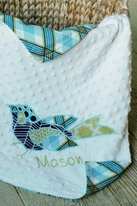 This applique baby blanket is just adorable, and it would make the perfect gift for a new baby! Make the blanket with this cute sewing project, and then stitch the baby's name onto the blanket for a more personalized gift.