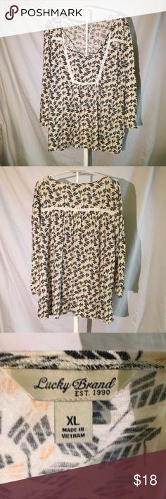 Lucky Brand top XL Lucky Brand shirt with cute geometric design. I love to wear these tops. 3/4 sleeve and flowy.  Approx measures  25 1/2 inches across chest, 30 inches across the bottom, top to bottom measures 26 inches long Lucky Brand Tops