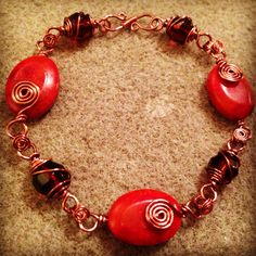 Bracelet......beautiful Coral oval gemstones wrapped in antique style copper wire with wrapped dark Amber Faceted Czech glass beads.  https://m.facebook.com/JulesLittleGems2011