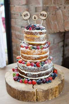 Rustic Wedding Cakes With Berry Decoration / http://www.deerpearlflowers.com/rustic-wedding-details-and-ideas/2/ - tiered naked brown chocolate fruit cake