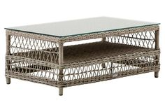 Sika Design A/S | Hazel Glass Coffee Table, Antiqued Brown | An exemplar of rustic elegance, this finely woven coffee table features a distressed gray finish and a sleek glass top. Crafted with durable polyrattan, this welcoming piece promises years of outdoor use | $829.00