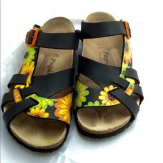 Shop Women's Birkenstock Orange Black size 9 Sandals at a discounted price at Poshmark. Description: Gently worn hard to find black with orange and green flowers women's Papillio by Birkenstock. Almost like new with minimal signs of wear. Cross straps over your toes. The buckled strap provides the comfort of a slip- on and keeps your feet secure at the same time. You can wear these year around. I wear mine with cashmere socks in the winter as long as there is no snow on the ground. No...