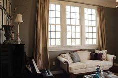 Sarah's soft golden drapes frame the windows with jeweled capped hardware.