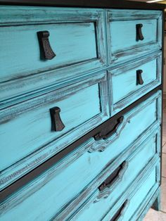 Destiny Decor Furniture:  Five drawer chest painted turquoise with satin black trim.