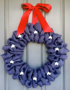 We love this 4th of July blue burlap wreath with stars. Created by WoulfsCreations. Found on etsy.