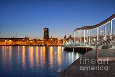 Rambla de Mar wooden promenade over Port Vell in city of Barcelona at night in Catalonia, Spain. #barcelona #spain #catalonia #night #city #cityscape #evening #rambla #ramblademar #portvell #promenade #sea #skyline #citybynight #citybreak #ramblamar #twilight #nightscape