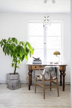 Vintage desk and wishbone chair in the dreamy, rural Swedish summer cottage of Erica Franzén.