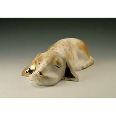 Dog Sleeping :: Pauline Pelletier, a ceramist by trade, works out of her workshop located in Old Cap-Rouge in Quebec City. She has been working clay for over forty years with ardor, pleasure and a constant councern with excellence. Her animals are in ceramic of Faïence with golden aplliques in real gold. Dog Sleeping, Quebec City, Lion Sculpture, Workshop, Clay, Statue, Gold, Animals, Art