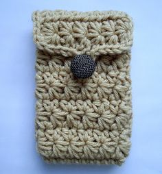 Cell phone cover with star stitch (crochet). Link to free pattern. Love this button better!!