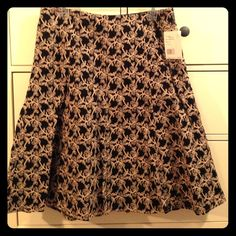 """Black Axcess Flared Skirt with Cream Embroidery NWT Axcess skirt that is black with a beautiful cream embroidered pattern. Skirt is 24"""" long, and 16"""" wide at the waistline! Has thick outer layer, and thin under layer. Skirt is in perfect condition! NO Trades NO PayPal Axcess Skirts A-Line or Full"""