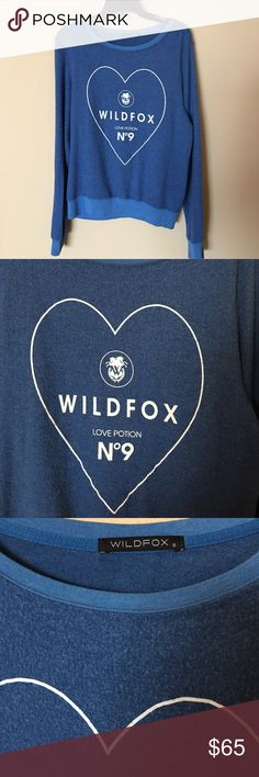 NWOT Wildfox Love Potion No 9 sweatshirt NWOT Wildfox Love Potion No 9 sweatshirt.  Polyester/Rayon/Spandex. Brand new without tags.  No trades.  Price is firm. Wildfox Tops Sweatshirts & Hoodies