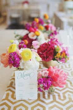 Floral filled wedding table: http://www.stylemepretty.com/2014/01/06/colorful-chateau-cocomar-wedding/ | Photography: Forever Photography - http://www.foreverphotographystudio.com/