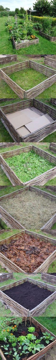 building lasagna raised bed garden. I love the walls built of fruit tree prunings.