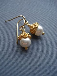 35f20b1cc White Pearl Earrings In Gold. Gold Earrings. These earrings are made from  Swarovski white