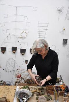Mari Andrews working in her studio.