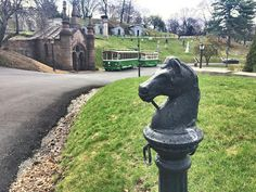 Horse head hitching post located in Green-Wood Cemetery, Brooklyn, NY. Used during America's Gilded Age - late 19th-century, for securing/tying up a horse. ~ {cwl} ~ (Image: Mental Floss - photographer: Allison Meier)