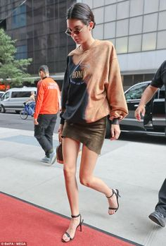 Glamorous: Kendall Jenner highlighted her long legs in a thigh grazing skirt, which featured an asymmetrical hemline