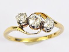 A superb quality antique English, solid 18 carat gold (stamped) ring. Beautifully made with crossover-style head, it's set with three wonderful sparkling white old mine-cut diamonds in silver-topped crown claw settings. Antique Gold Rings, Crossover Ring, 18k Gold, Heart Ring, Indie, Art Deco, Wedding Rings, English, Jewels