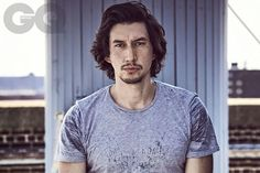 """Adam Driver looking straight ahead, in gray t-shirt looking shaggy on GQ. Intense.  """"An unconventionally attractive boy."""" http://www.gq-magazine.co.uk/article/adam-driver-star-wars-the-last-jedi"""