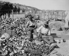 Gallipoli 1915, British soldiers making bombs from empty jam tins, filled with scraps of metal, barbed wire and shell fragments, circa 1915. They were first used on 4 June 1915 before the Third Battle of Krithia.