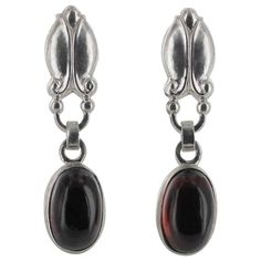 Georg Jensen Garnet Earrings No.17. Georg Jensen sterling silver with earrings with Garnet Cabochons.Imropessed company marks for Georg Jensen Denmark no17 Sterling. c after 1945